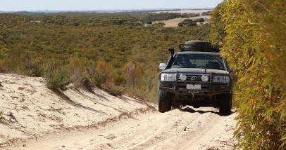 Tony O climbing a dune